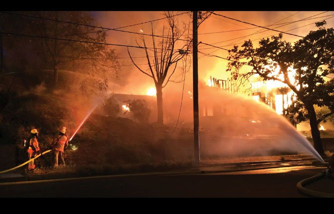 MID-COLUMBIA Fire and Rescue responded last night, June 17, to the second fire at a historic Fourth Street house and the latest blaze is destroyed the structure that was left vacant after the first fire in 2011.