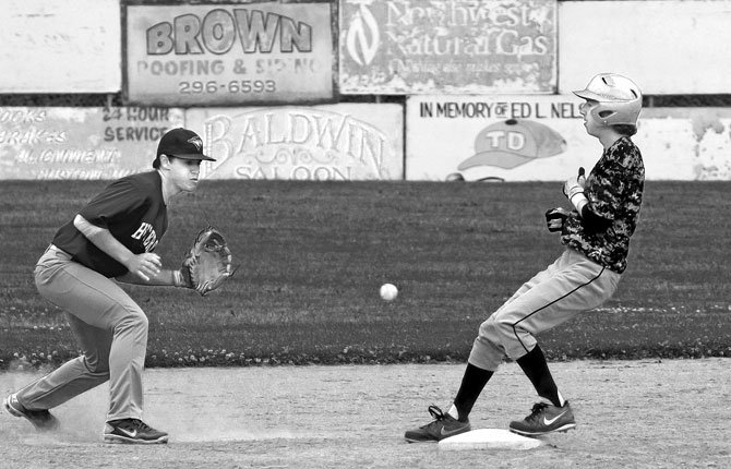 """Payton Eaton, left, fields a late throw to second during an earlier Hustlers """"AAA"""" team home game. The team dominated against the Irrigon Vandals in a twinbill June 17 on the road.Mark B. File photo"""