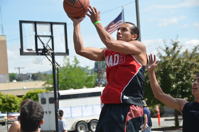 Blake Marchand goes to the hoop during Omak Battleground action Saturday.