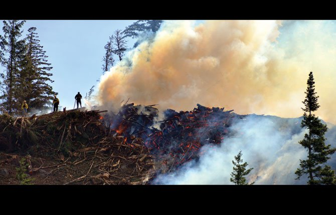 Firefighters work a line on the Owens Fire south of Hood River Wednesday, June 18.