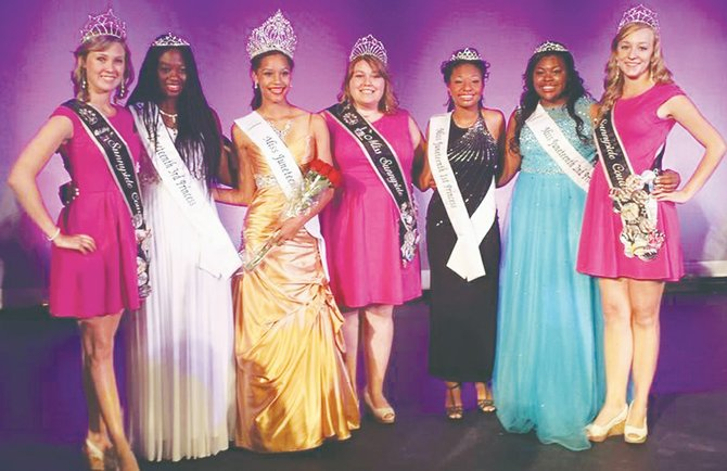 The Miss Sunnyside Court attended the Miss Juneteenth Pageant last Saturday at Pasco High School. Two of the candidates, who are immigrants, performed cultural dances from their native Africa. At the awards and dance reception held at the Pasco Red Lion, Natajiauna Sparks won the hostess award. Dina Gebretatios won the talent award. Kayla Brown was honored for selling the most tickets. Yaye Sidibe won the congeniality and academic awards. Pictured are (L-R) Sunnyside first princess Ashley Davis, Juneteenth third princess Yaye Sidibe, Miss Juneteenth Queen Rachel Moore, Miss Sunnyside Alyson Spidle, Juneteenth first princess Alexzondria Montgomery, Juneteenth second princess Natajiauna Sparks and Miss Sunnyside third princess Leah Diddens.