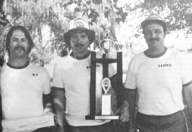 "1984: Sunnyside firefighters Bob Johnson, Steve Hazzard and Lloyd Hazzard proudly displayed a trophy won in the ""Hose Evolution Contest,"" a competition between firefighters from different municipalities. Firefighters had to hit a series of targets with water, using fire hoses for the honor of being awarded the trophy."