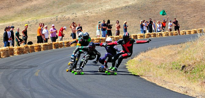 Racers rip down the Maryhill Loops Road during the 2013 Maryhill Festival of Speed. Spectators get an up close and personal view of the action along the 2.2-mile course.