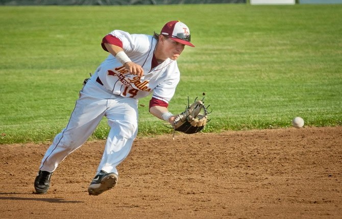 SHORTSTOP STEVEN Bartells reels in a catch in 2014 The Dalles High baseball action. Bartells has agreed to play baseball for Concordia University, a Christian university in northeast Portland.