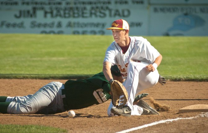 The Dalles first baseman Austin Wilson fields a pick-off attempt during The Dalles Eagle Indians baseball earlier this year.