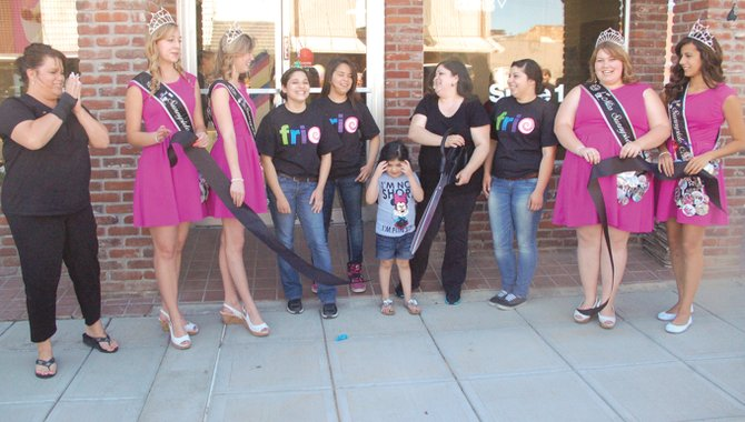 Participating in a grand opening celebration held last Friday in downtown Sunnyside are the Miss Sunnyside Court and the owner and staff of Frio. Joining in the traditional ribbon cutting ceremony are (L-R) Sunnyside Chamber of Commerce Executive Director Pam Turner, Miss Sunnyside Princesses Leah Diddens and Ashley Davis, Frio employees Vanessa Lopez and Christina Lopez, Emma Alvarez and her mother, Frio owner Maggie Alvarez, shop employee Samantha Lopez, Miss Sunnyside Alyson Spidle and Miss Sunnyside Princess Tiana Perez. The 525 S. Sixth St. shop opened on May 2.