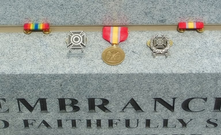 "The five medals and ribbons found early Sunday morning at Sunnyside's Jerry Taylor Veterans Memorial Plaza have been identified as an Army Service Ribbon, the National Defense Medal & Ribbon, a ""marksman"" medal for rifle proficiency and an ""expert"" rifle shooting ribbon."