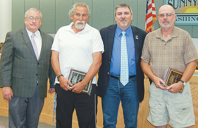Two city employees retiring from the city's sewer department were honored last night for their work. Picture (L-R) are Sunnyside City Manager Don Day, retiring Sewer Division Superintendent Joe Ortega, Sunnyside Mayor Jim Restucci and retiring Sewer Division Assistant Superintendent Don Clift.