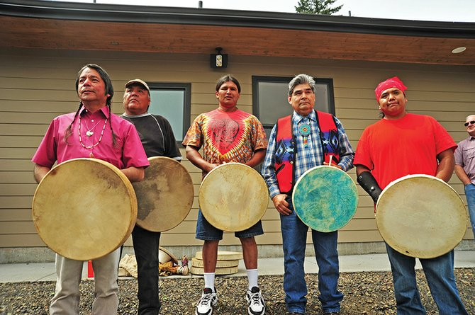 UMATILLA tribal members Armand Minthorn, left, David Thompson Sr., Tommy Pierre, Woodrow Star, and Sam Spino, of Pendleton, who performed the blessing at Brigham Fish Market.