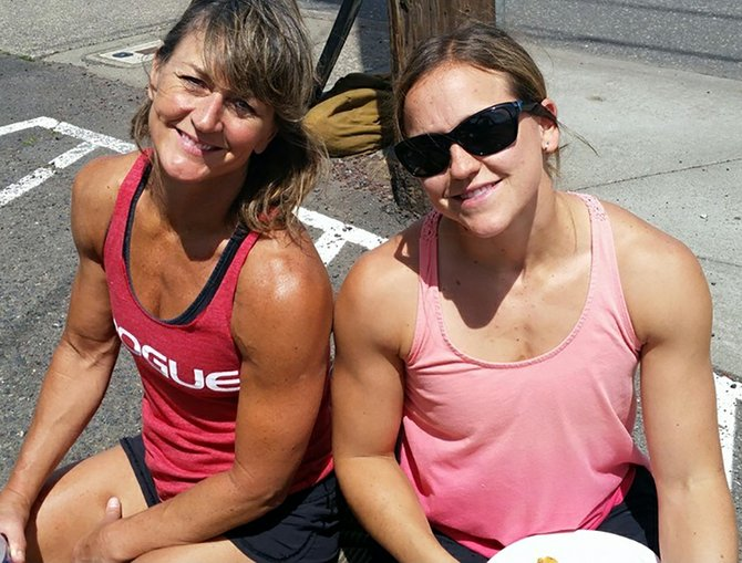 CrossFit Games qualifiers Christine Wells and Regan Huckaby are training hard for the worldwide contest in July.