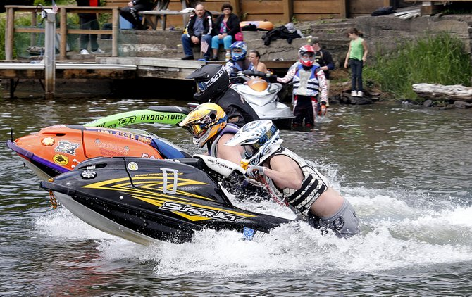 Jet Ski racers fly off the startline during the 2013 Devils Lake Dash in Lincoln City, Ore.