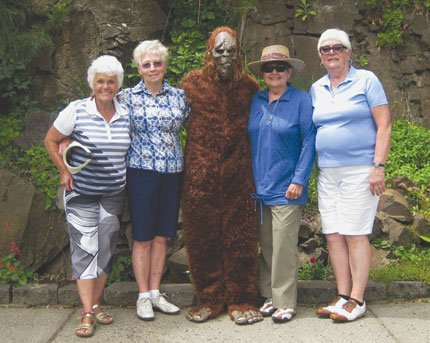 "NET TOURNAMENT winners at the 40th annual Sasquatch 4s Women's Best Ball event included Darlene Barber, Beverly McKinney and Marylee Webber of The Dalles and Pat Edmondson of Hermiston, pictured with ""Sas,"" the Sasquatch.