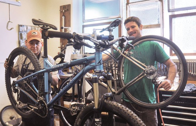 JOE CRUZ, left and Jake Felt, owner of Dalles City Cyclery, are seeking residents interested in helping to develop a proposal for a local bike park. They see the track as not only a fitness outlet but a potential economic development tool.