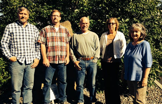YOUTH EMPOWERMENT Shelter board members (from left) are:  Douglas Quisenberry; Chris Seeley; Richard Kessler, consultant; Teddy Evans; and Linda Casady, president of the organization.