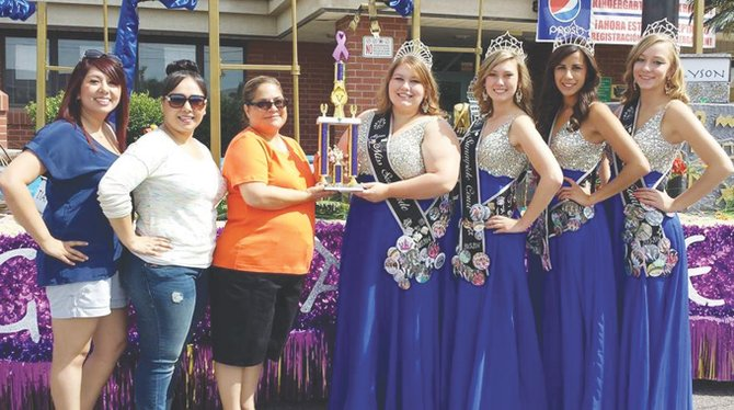 "The Sunnyside community float, ""Egyptian Treasures,"" earned firstplace honors at the Mabton Community Days Parade last Saturday. Pictured presenting the Mabton Community Days first-place trophy are (L-R) Mabton float judges Felicia Moreno, Liz Lozano and Tawnya Ibarra to Miss Sunnyside Alyson Spidle and Sunnyside Princesses Ashley Davis, Tiana Perez and Leah Diddens."