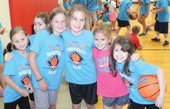 AT THE Jumpstart Basketball Camp, children make friends all in the name of fun while learning hoops skills. For the 21st season, the camp has grown to its highest level ever with resounding success.              Contributed photo
