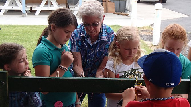 4-H Volunteer Polly Hollandsworth teaches Idaho County 4-H members how to braid. L to R Miranda Klapprich, Miriam Fuller, Polly Hollandsworth, Chloe Rowland, unidentified.