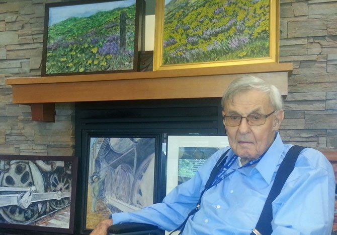 ED BONHAM displays his watercolors June 27 at The Springs at Mill Creek. His latest are paintings of lupine, above, while train wheels also featured in the exhibit.
