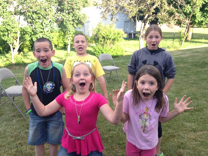 "Grangeville Gospel Tabernacle hosted its ""Weird Animals"" vacation Bible school program in June. Here, kids enjoy some ""weird"" faces at the summer event. Check faith briefs for additional upcoming VBS programs in Idaho County."