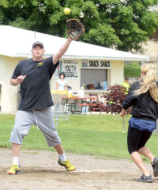 John Cline of Grangeville snags a high throw at the first Warbird Weekend softball tournament fund-raiser last Saturday, June 28, at Lions Park.