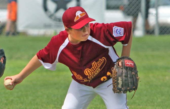 TAYLOR ROUTSON, of The Dalles' 10 to 11-year-old All-Stars scoops up a slow roller in action Monday in Hermiston. In the game, TD scored five runs in the sixth inning to defeat Hood River to keep their season alive. This squad played today in the consolation bracket and needs four straight wins to advance to the state tournament starting on July 12 in Tigard.