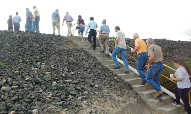 Sunnyside Daybreak Rotarians climb the stairs on their way to inspect the Port of Sunnyside's existing lagoons, as part of a tour to learn more about the Port's anaerobic digester construction site.