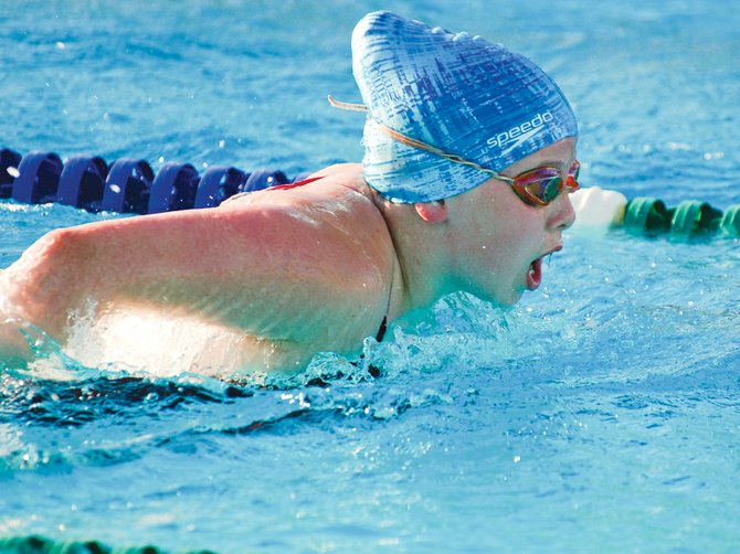 Grandview's Emma Febus nears the finish line in the 40-yard butterfly at Tuesday night's home swim meet against Othello.