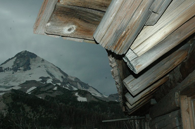 RUSTIC EAVES of Cloud Cap Inn frame Mt. Hood and Eliot Glacier. Tours of the inn, beginning July 27, provide a glimpse inside a true Hood River County treasure, and some of the best views of the mountain anywhere.