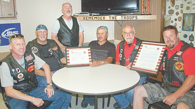 The Sunnyside AMVETS Riders, Chapter #3733, received its official charter this week. Local chapter member (L-R) Nick Myers, potential member Leon Brons, along with members Phil Hill, Ernie Duran, Don McCracken and Dave Ricard, chapter president, met Wednesday night at the SunnyView VFW Post, where the AMVET Post #3733 regularly meets.