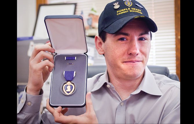 PATRICK WILBERN, a staff sergeant in the Oregon National Guard, will be one of the Hometown Heroes honored by KODL at Friday's Fourth Of July festivities in The Dalles.  He is shown with the Purple Heart he earned as a result of  injuries received during a 2010-11 deployment to Iraq. Wilbern is looking for other medal holders to start a Military Order of the Purple Heart chapter.