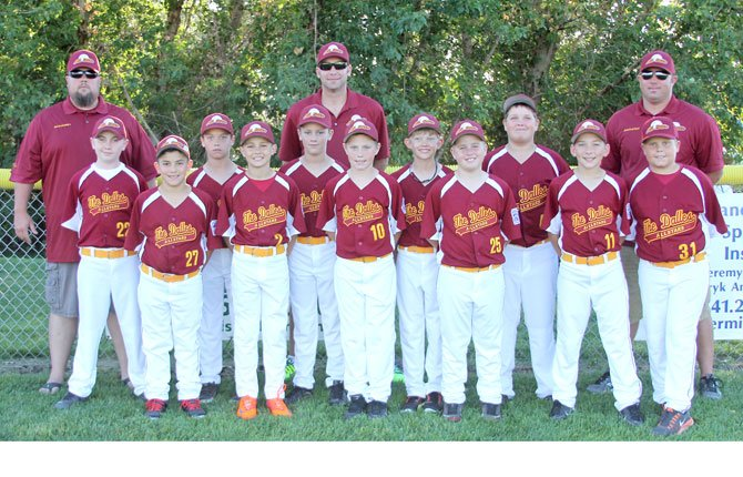 THE DALLES 10-11 Little League All-Stars (pictured from left to right),Spencer Guscette, Giovanny Avila, Ben Schanno, Jaxon Pullen, Jacob Buell, Conner Cummings, Caleb Nelson, Isaac Anthony, Trenton Schacher, Taylor Beeks, Taylor Routson.  Back Row, left to right, Coach Chris Schanno, Manager Greg Cummings, Coach Deric Anthony come together for a group shot at Kramer Field. The team lost their final game, 11-9.
