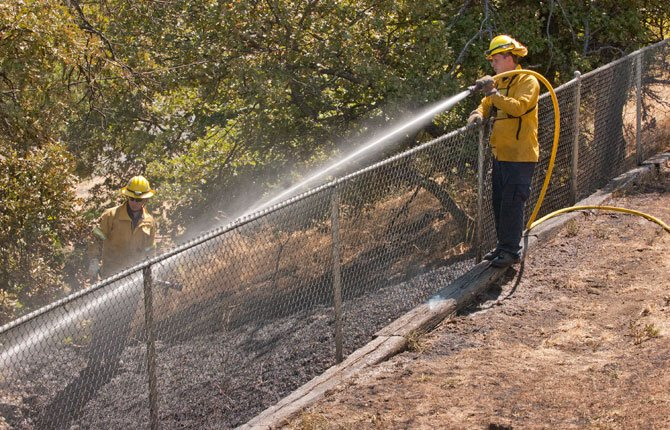 Crews from Mid Columbia Fire and Rescue and Dallesport responded to a brush fire that started below the south end of the pedestrian bridge over Mill Creek, in the area of Mama Janes on Sixth Street Saturday morning, July 5. Cause of the fire is under investigation.