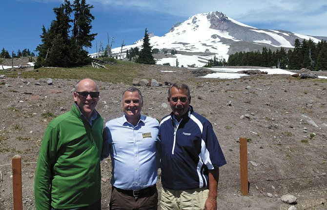 U.S. Rep. Greg Walden, left, stands with John Tullis, director of public affairs for Timberline Lodge, and House Speaker John Boehner at the lodge July 2. Boehner took time out of private meetings with Republican leaders in the state to make two stops in the gorge and enjoy lunch at the historic Mount Hood facility.