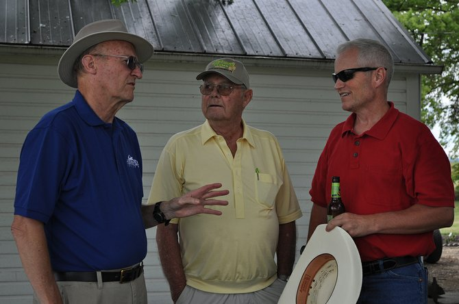 (L-R) ISHS board member Earl Bennett talks with James and Mike McDonald prior to last Friday's Century Farm presentation.