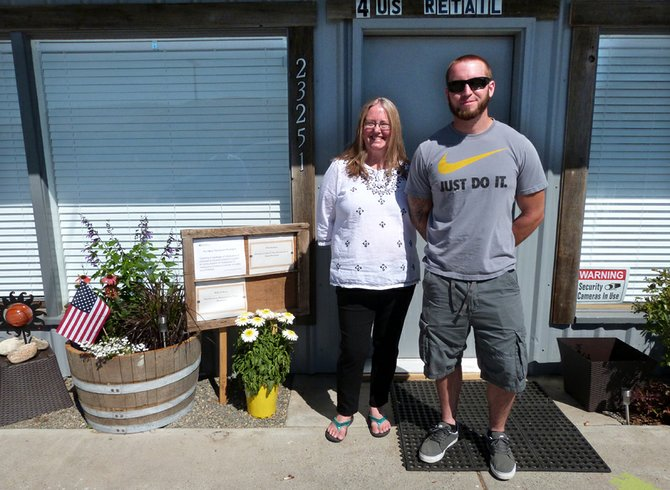 Teresa Tindoll, left, and Sean Sheehey plan to open their marijuana retail business, 4US Retail, on Friday at 23251 state Highway 20. They are awaiting product, which must be tested prior to being sold.