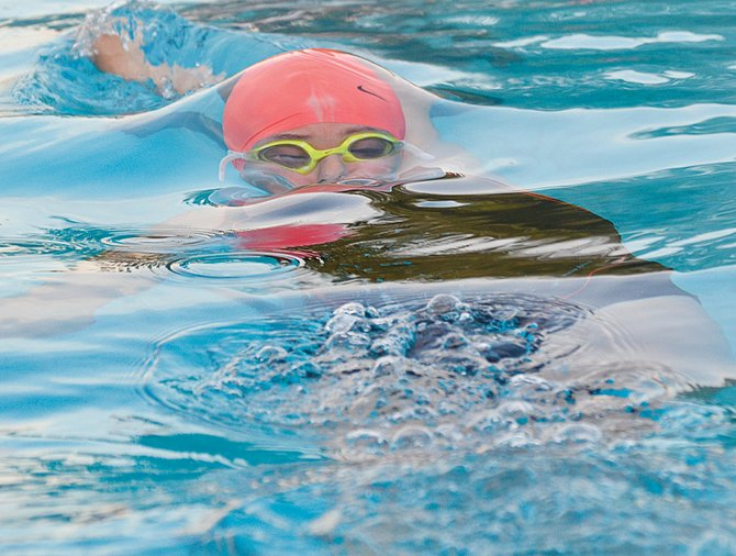 Kamryn Serl of Grandview surfaces at the start of the girls 14&U, 40-yard backstroke race Tuesday evening. Serl raced to a clocking of 37.46 seconds. Sunnyside's Kylah Bunch was the winner (28.99).