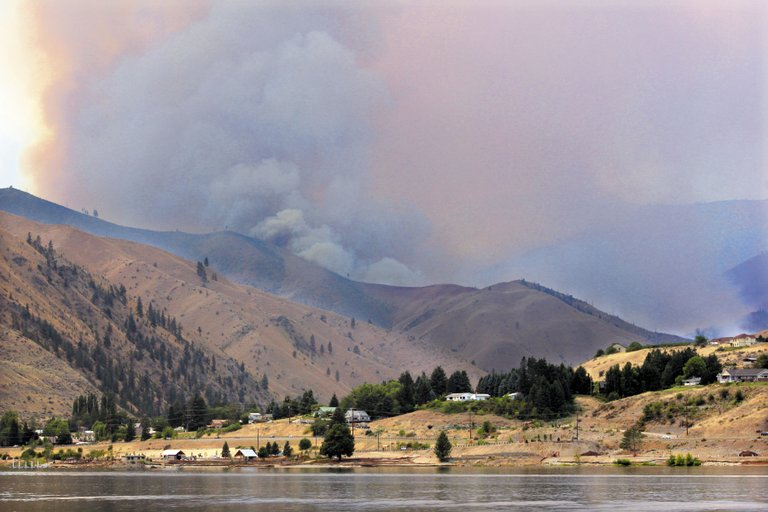 Smoke from the Mill Canyon fire billows above a ridge west of the Columbia River.