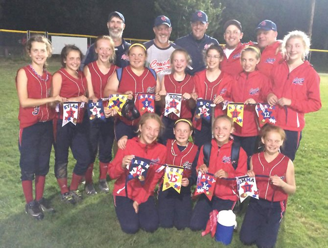 MEMBERS OF THE 12U Cherry City Crush softball team were weary and worn, but not too much to share a hearty smile in a group photo after scoring fifth-place recognition at the ASA State Softball Tournament in Albany. Overall, the team posted a 2-3 record with all three losses coming by one run, two in extra innings. Pictured from left to right are,  back row: Mike Kelly, Roger Hoylman (co-head coach) Leroy Tharp (co-head coach), Ryan LeBreton and Rich Belanger; middle row: Kylan McCavic, Kilee Hoylman, Sydney Fransen, Savannah Ford, Maddie Tharp, Grace Schatz, Alyse Wentz and Mikayla Kelly; front row: Lauryn Belanger, Rochelle Tilton, Bailey LeBreton and Emma Smith.  Contributed photo