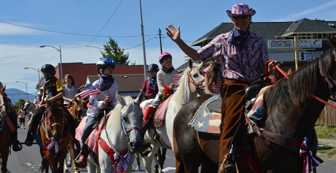 PONY PAL riders, with Margo Goodman at the lead, ride in the Hood River July 4 parade.