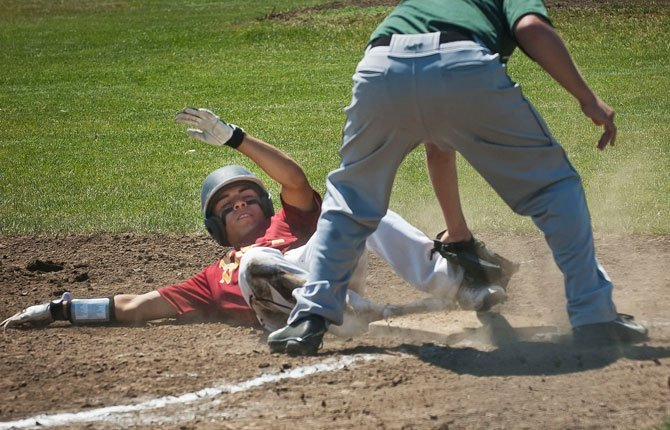 Izaac Tapia, left, slides safe to Third as batter Denzel Arrellano (not pictured) sends a runner to home on a hit.