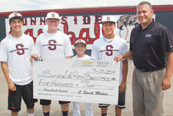 Sunnyside summer youth baseball programs just received a financial boost, thanks to C Speck Motors in the form of a $500 donation. According Dave Martinez, a youth baseball spokesman, the money will be used to cover tournaments costs, including umpire fees. Pictured accepting the donation are (L-R) Babe Ruth players Tim Martinez and Damon Hurst, Cal Ripken player Jacob Martinez and Babe Ruth player Jacob Mendoza.  Representing C Speck Motors is Jesse Arriaga, who also said that for every family member and friend of youth baseball who test drives a C Speck car between now and July 31, Chevrolet will donate $25 per test drive, up to $500 per local baseball program, as a part of the Chevy Youth Baseball test drive campaign.