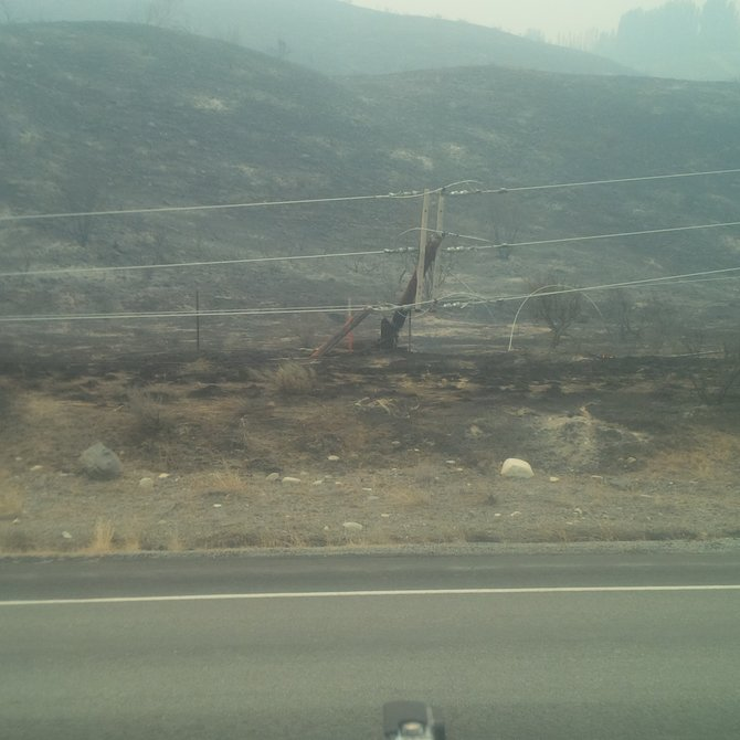 One of the hundreds of power poles damaged by fire.
