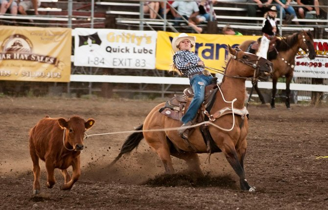 Shebly Kaser of Centerville, Wash., applies the brakes during breakaway roping competition at the Rough and Wild Fort Dalles Day Rodeo Thursday night. She scored at 4.5 seconds. Rodeo action continues tonight and Saturday at 7:30 p.m. Tonight is Tough Enough to Wear Pink night, a benefit for breast cancer causes. Tomorrow is military night offering discounted tickets with military identification.