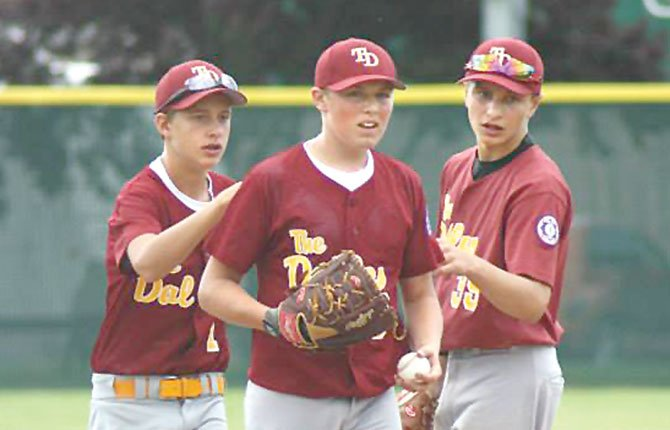 THE DALLES All Star pitcher Kolbe Bales (middle) is encouraged by teammates Brody Woods (left) and Jacob Justesen during Babe Ruth baseball action. In two pool play games played Thursday in Portland, TD posted a pair of lopsided wins over East Portland Metro and David Douglas.