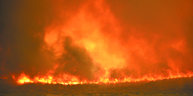 Flames rage near Indian Dan Canyon road north of Pateros on Thursday afternoon.