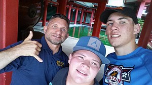 Three amigos in Japan:HRVHS wrestling coach Trent Kroll and wrestlers MaxLane and Andrew DeHart pose for a photo while visiting a shrine in Japan.The three were in the country this summer as members of a cultural exchange wrestling team.