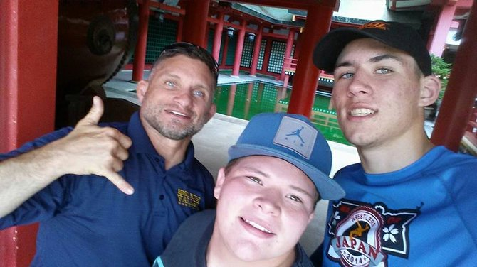 Three amigos in Japan: HRVHS wrestling coach Trent Kroll and wrestlers Max Lane and Andrew DeHart pose for a photo while visiting a shrine in Japan. The three were in the country this summer as members of a cultural exchange wrestling team.