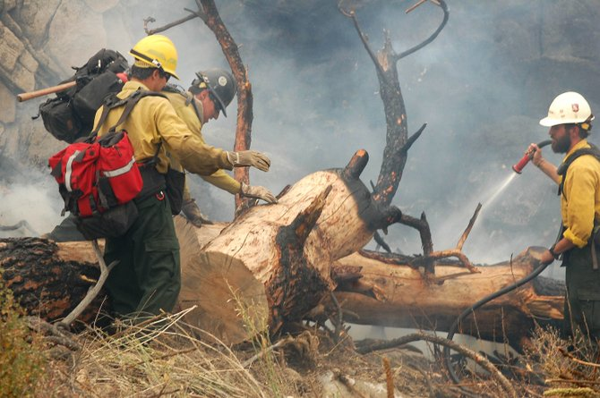 Salmon River hot shot firefighters from Klamath National Forest, Ore., work the fire line along West B&O Road, north of Malott.