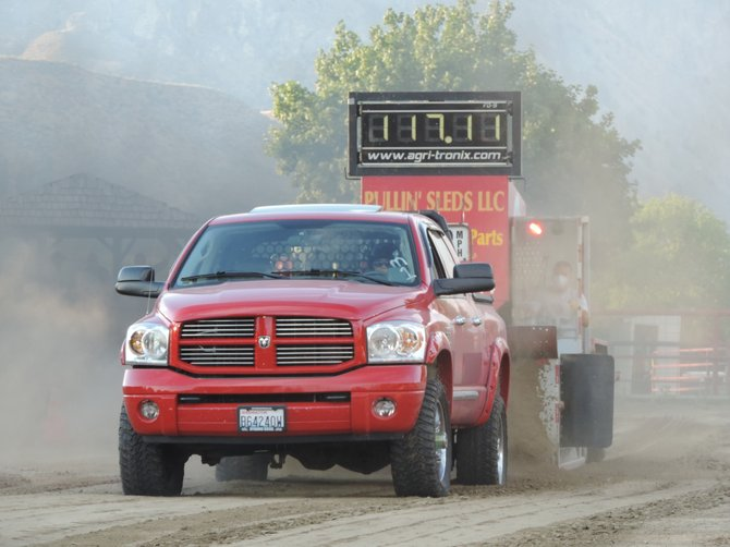Tricia Burton of Rockford, takes home 3rd place in the modified diesel category at the Tonasket Truck and Tractor Pull.