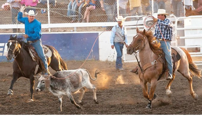 A pair of Klickitat County cowboys, Jesse Kayser of Centerville and Coby Tobin of Goldendale, compete in team roping at the 49th annual Fort Dalles Days Rough and Wild Rodeo at Milt Tumilson Arena in The Dalles. Hermiston's Jake Stanley and his mate, Renton City, Wash.'s Bucky Campbell, dusted off a 4.6 to take over the leaderboard for first place.